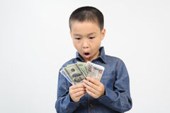 Young boy excite with bank note. Young boy excitewith american and korean bank note in his hand Stock Image
