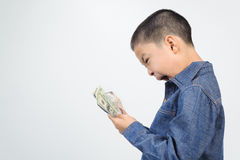 Young boy excite with bank note. Young boy excitewith american and korean bank note in his hand Royalty Free Stock Photography