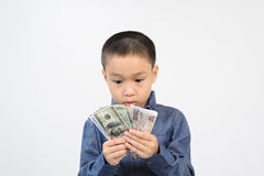 Young boy excite with bank note. Young boy excitewith american and korean bank note in his hand Stock Photo
