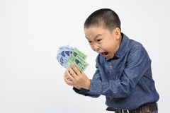 Young boy excite with korean won bank note. In his hand on white background Stock Photography