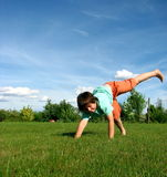 Young boy exercising in the garden Stock Images