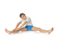 Young boy exercising Stock Images