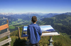 Young boy exploring the Alps mountains in Tirol Royalty Free Stock Images