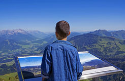 Young boy exploring the Alps mountains in Tirol Royalty Free Stock Image