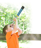 Boy Exploring Nature in the Woods royalty free stock photos