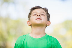 Young boy with eyes closed. In park Royalty Free Stock Photography