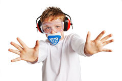 Young boy face mask and ear protection.. Boy with hazard protection. Face mask, eark protection and air filter. Shot in the studio against a white background Royalty Free Stock Images