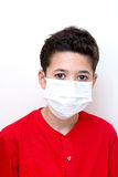 Young boy with face mask on. Royalty Free Stock Images