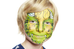 Young boy with face painting monster. Smiling on white background stock image
