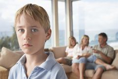 Young Boy With Family At Home royalty free stock images