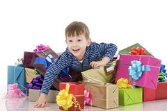 Young boy and fancy boxes Royalty Free Stock Photo