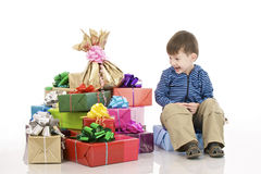 Young boy and fancy boxes Stock Photography