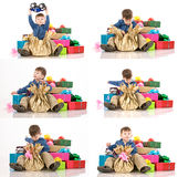 Young boy and fancy boxes Royalty Free Stock Photography