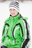Young boy in fashionable winter clothing Stock Photo