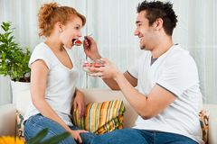 Young boy feeding a beauty girl  strawberry Royalty Free Stock Photo