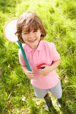 Young Boy In Field With Net And Bug Catcher Royalty Free Stock Photos