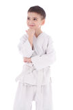 Young boy fighter in kimono with hand under the chin thinking Royalty Free Stock Image