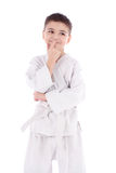 A young boy fighter in white kimono Stock Image