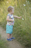 Young boy filled with wonder while going for a walk Stock Photos