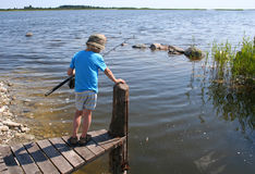 Young boy fishing. A young boy fishing at a sea Royalty Free Stock Image