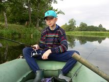 Young boy fishing. Boy fishing on the river Royalty Free Stock Photography