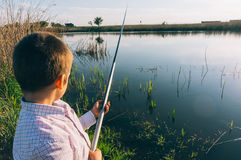 Young boy with fishing pole Royalty Free Stock Photography