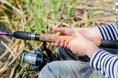 Young boy fishing with a spinning reel Stock Image