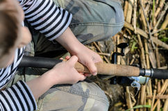 Young boy fishing with a spinning reel Royalty Free Stock Photography