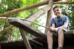 Young boy fishing in the woods on bridge. Kid scout on old wooden bridge in forest Stock Images