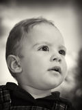 Young boy fixedly looking forward Royalty Free Stock Photography