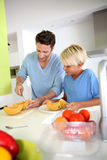 Young boy fixing dinner with daddy Royalty Free Stock Photo