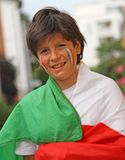 Young boy with flag before the football match Stock Images