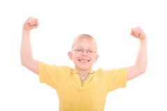 A young boy flexes his muscles Stock Photos