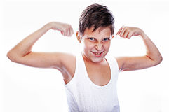 Young boy flexing biceps Stock Photos