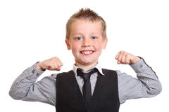 Young Boy Flexing his muscles. Seven year old boy acting like a strongman Stock Photography