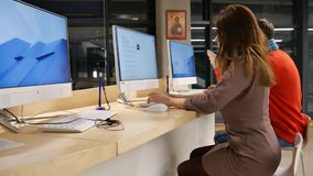 Freelancers at work in office stock video footage