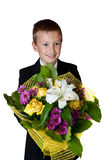 Young boy with flowers Royalty Free Stock Photo