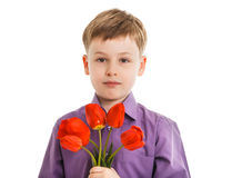 Young boy with a flowers isolated Royalty Free Stock Images
