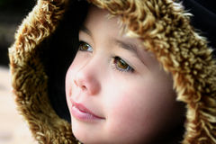 Young boy with fluffy hooded winter coat Royalty Free Stock Images