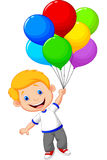 Young boy flying with balloon Stock Photo