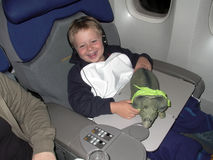 Young boy is flying business class Royalty Free Stock Photo