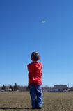 Young boy flying a kite stock photo