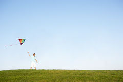 Young boy flying kite in a field Royalty Free Stock Image