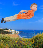 Young boy flying Stock Photo