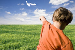 Young boy flying a paper plane Royalty Free Stock Image