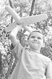 Young boy flying plane Royalty Free Stock Photography