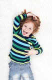 Young boy fooling around and playing on the floor Royalty Free Stock Image