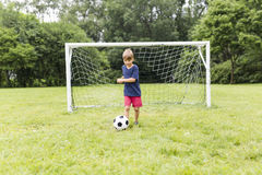 Young Boy with football on a field having fun Stock Photography