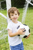 Young Boy with football on a field having fun Stock Photos