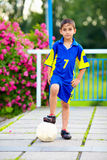 Young boy, football player with ball Royalty Free Stock Photo